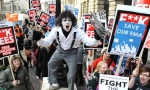 Students, one dressed as Edward Scissorhands, demonstrate against higher tuition fees and cuts in university funding.